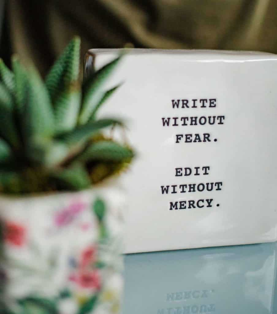sign that says write without fear, edit without mercy.